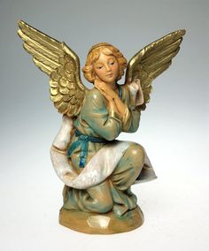 A Very Nice, Vintage, Fontanini, 5 Scale, Kneeling Angel, Nativity Figurine. Dated 1994, this piece has typically remarkable, Fontanini detail. Condition is Excellent, with no chips, cracks, breaks, or repairs. Complete w Box and Story Card. Has Fountain Mark. Please See Photos to Fully Appreciate. A Lovely addition to Any Nativity or Fontanini Collection.