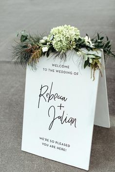Topped with a spray of hydrangea and greens, an all-white A-frame sign, by Rebecca of Rebecca Ann Designs, was simple and sweet.