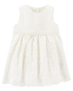 Her sweetest dress of the season. This one features pin-tuck details, pretty embroidery and a full lace skirt, perfect for her first celebration.