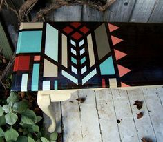 table repainted with a pretty geometric pattern.