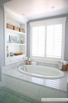 Beautiful!  I want!!!! Master Bath. Faucet, wood surround, wall shelves, marble around tub. Need to get a tub same length, but narrower - not as wide, shutters.