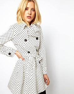 The classic trench with a twist: patterned.  The small-print pattern and neutral colors make it wearable with most outfits. Also, it's the perfect excuse for a statement shoe!   ASOS Spot Skater Mac