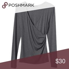 """LAST ONE❗️NWT Banana Republic Gray Wrap Top NWT.  Gray faux wrap top with long sleeves.  Ultra soft.  Modal/Polyester/Spandex.  Approx measurements laying flat: Medium - chest 17.5"""", length 25"""".  Banana Republic Factory.  Also available in ivory and coral under separate listings. Banana Republic Tops Tees - Long Sleeve"""