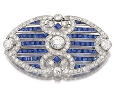 SAPPHIRE AND DIAMOND BROOCH, CIRCA 1910.  Designed as an open work plaque millegrain set with calibré-cut sapphires, circular-cut and rose diamonds, indistinct marks, fitted case signed London & Ryder, 17, New Bond St., London, W.