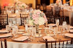 THIS!! Champagne linens with mahogany chiavari, i think this would look great with our gold mercury glass centerpieces....blush ivory centerpieces with greens