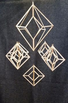 Elina Mäntylä, designer and owner of Valona Design, creates laser cut Finnish birch plywood geometric himmelis that make beautiful holiday or year round decoration. Himmeli mobiles, called straw chand