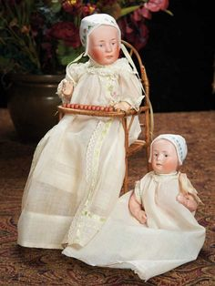 """Two German Bisque Bonnet Babies by Gebruder HeubachMarks: 7977 Heubach (sunburst) 3 (on larger, 0 on smaller) Germany. Comments: Gebruder Heubach, circa 1910, the model known as Baby Stuart.  12"""" & 9"""" tall"""