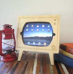 Handmade Natural Wood Ipad Dock  Retro TV - Ginger absolutely cannot live without her iPad. This dock is super adorable, and handmade from natural wood. Bing Bing can (almost) watch her online shows from a real TV! Price: $60.00  http://www.etsy.com/listing/102734784/handmade-natural-wood-ipad-dock-retro-tv