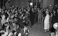 Marilyn's arrival at a press conference at the Savoy Hotel in London to publicise her forthcoming film The Prince and the Showgirl, 1956.