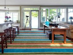 """8 Things You Didn't Know You Could Paint : Home Improvement : DIY Network """"Yes, you can paint carpet. Cover pesky stains by creating stripes or custom patterns. Here, Joanne Palmisano turned a low-pile carpet remnant into a beautiful area rug. Painting Carpet, Diy Painting, Painting Rugs, Painting Doors, Living Room Paint, My Living Room, Living Area, Behr, Interior Paint Colors"""