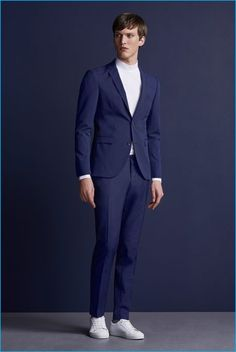 Malthe Lund Madsen dons a blue suit with white sneakers from Premium by Jack & Jones' fall-winter 2016 NOOS collection.