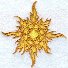 Celtic knotwork weaves to creating a golden sun surrounded by firey flames.