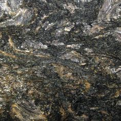 COSMOS. Gold and silver mica and quartz on a black background. Exquisite granite color available at Knoxville's Stone Interiors. Showroom located at 3900 Middlebrook Pike, Knoxville, TN. www.knoxstoneinte... FREE Estimates available, call 865-971-5800.