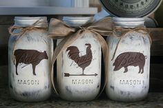 This trio of farmhouse mason jars is just what you need to add rustic charm to your decor. Jars are painted in brown and vintage white and then distressed. The rooster has a 3 inch ribbon tied to it, the other two have twine tied to them. The jars would be great in a kitchen or on a table or used as your centerpiece. I bet someone would love to receive them as a gift, so that is a great option as well! Jars are sprayed with a sealant to prevent chipping. You can purchase as a set which is…