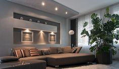 Stylish lounge with low profile lighting in rear wall shelving