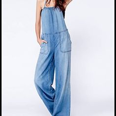 Free People One Piece Chambray one piece. Soft wide leg denim with deep set pockets and cross cross back. 100% cotton. Awesome one piece with a current 70's vibe! I have worn once and on the fence about selling.  Free People Pants Jumpsuits & Rompers
