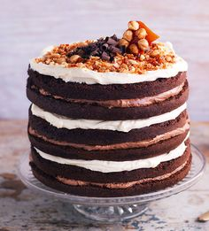 This delicious layer cake is sandwiched with white chocolate icing and Nutella icing and topped with a super crunchy (and beautiful!) hazelnut praline. | Tesco