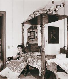 "Frida Kahlo sitting beside the bed painted in the work ""The Dream"", 1940. Image © Bernard Silberstein."