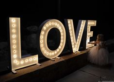 """These are so cute for a wedding and make big statement! DIY LOVE marquee letters that are 40"""" tall and made from wood. Free plans + building tutorial."""