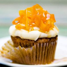 These Carrot Cake Cupcakes feature a rich and creamy cheesecake frosting. More spring desserts: http://www.bhg.com/recipes/party/seasonal/spring-baking-ideas/?socsrc=bhgpin060213carrotcake=4