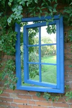 Garden mirror with optical illusion frame... love it!