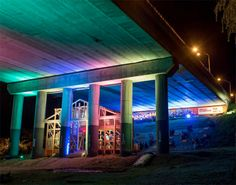 An abandoned, deteriorating bridge in the city of Kosice in Slovakia has been rehabbed and modified to serve as an amphitheater and public gathering space that glows in bright rainbow colors at nig… Parasitic Architecture, Orlando, Old Abandoned Buildings, Urban Intervention, Bridge Design, Light Installation, Public Art, Public Spaces, Urban Planning