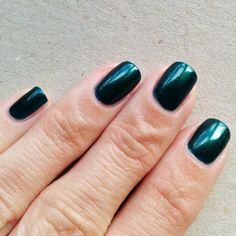 Barry M British Racing Green, 3 coats. Lovely colour, very easy to work with.