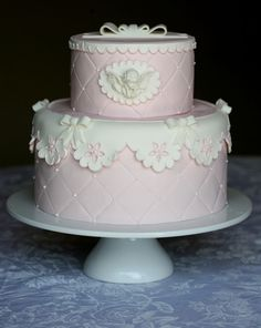 Light pink quilted cake with off white scallop lace border by Cupcake