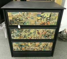 Batman dresser, furniture, handcrafted with comics.  Handmade drawer knobs.  www.facebook.com/pnugg