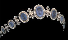 Cameo Diadem of Empress Josephine: This diadem is made from lapis cameos and delicate pearls set in gold. The center cameo portrays Napoléon Bonaparte. Notice how the raised sculptures are a bit darker than the background.