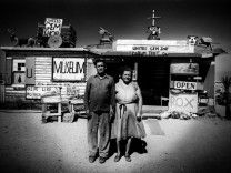 Call and Ruby Black in front of their museum, Mojave Desert, USA, 1960 by Ed van der Elsken