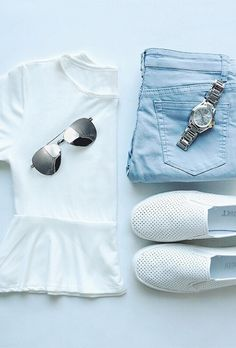 {easy chic} - pale denim jeans, white peplum top and canvas or tennis shows with a statement watch and mirrored sunglasses...x
