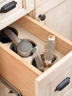Vanity drawer set up like a salon station with bins that can handle hot hair styling tools and hold brushes, etc. Genius & easy!