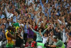 Olympic Photos From London 2012 - Usain Bolt steals a photographers camera and takes pictures of the crowd