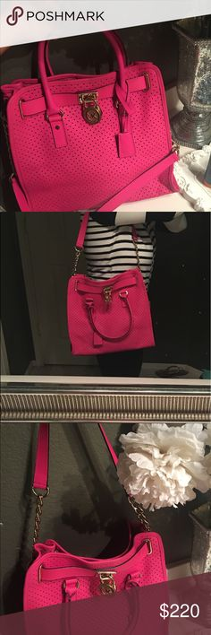 Perforated Hot Pink Michael Kors Hamilton Purse This purse is super cute and can add the perfect pop of color to any outfit! It's gently used, roomy, and adorable! Michael Kors Bags