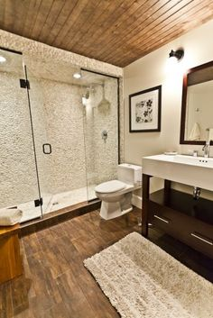 Stone walls, wood ceilings. Natural bathroom.