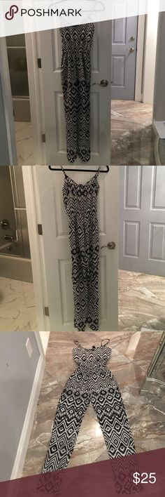 Aqua black and white jumpsuit Aqua black and white jumpsuit. Adjustable Spaghetti straps. Banded waist. Also has pockets. Size xs. Worn twice, very good condition. Aqua Pants Jumpsuits & Rompers