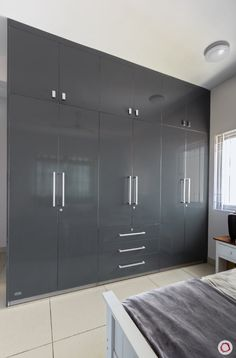 Looking for a home designed by Livspace in Prestige Sunrise Park, Bengaluru? This is modern and minimal, done up in very subtle colours. Wall Wardrobe Design, Bedroom Built In Wardrobe, Wardrobe Interior Design, Wardrobe Door Designs, Closet Designs, Home Interior, Interior Paint, Kitchen Wardrobe Design, Closet Built Ins