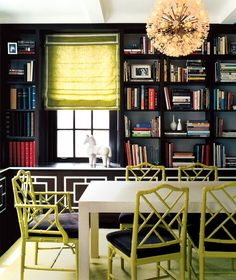 Surround dark walls with a pop of lime green chairs and window shade. Rescue boring bookshelves
