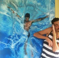 Artist Poses Playfully with Incredibly Lifelike Paintings of Swimmers - My Modern Met