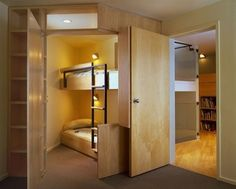 Walk-in closet converted to bunk bed hideaway.  Another nifty use of space.