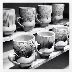 Adam Field  |  Drying mugs with carving.