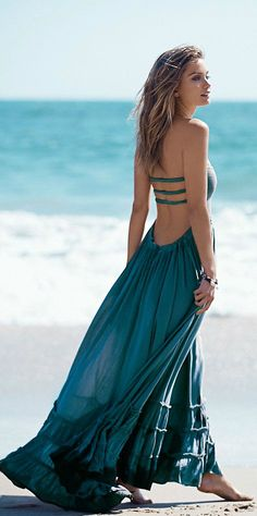 I really love this dress! Especially the unique back. And the color compliments my back tattoo