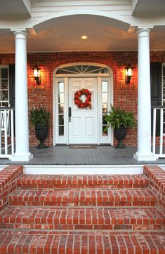 Do you have a white front door? Check out tips, inspiration, paint colors, accessories, and more for beautiful porches with a white front door. Front Porch Steps, Farmhouse Front Porches, Front Porch Design, Porch Designs, Brick Porch, Concrete Porch, Brick Steps, Wood Steps, Simple Fireplace