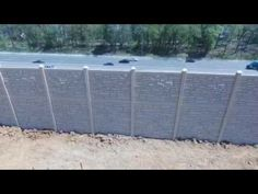 Fence & Deck Connection: SimTek Ecostone Fence was used as a sound barrier wall for a community that backs up to a beltway. Drone footage.