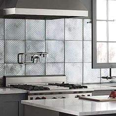 Mirror Backsplash. Mirrored tiles from Ann Sacks lend industrial chic design to any kitchen. The hand-silvered tiles have been given a faux aged treatment so they appear well-loved yet still crisp and modern.