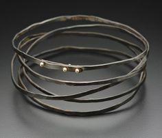 Bracelet |  Peg Fetter.  Steel and 14k yellow gold