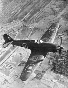 A view of a machine gun armed Hawker Hurricane in flight over Bengal Ww2 Aircraft, Military Aircraft, Hawker Hurricane, Airplane Fighter, Air Festival, Ww2 Planes, Vintage Airplanes, Battle Of Britain, Military Equipment