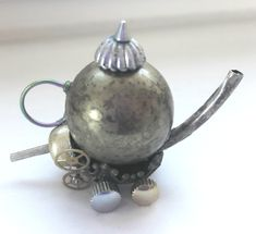The latest utterly useless but adorable eccentricity to be found at my #etsy shop: Steampunk Racing Teapot Miniature OOAK Model https://etsy.me/2yPjkuK  #steampunk #miniaturemodel #steampunkteapot #teapotracer #steampunkmodel #ooakminiature #originalgift #uniqueitem