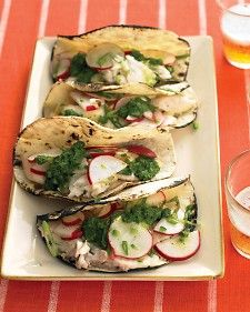 Fish Tacos with Salsa Verde and Radish Salad. Fish tacos often involve deep-frying and heavy sauces. But here, broiled tilapia is topped with a crunchy radish salad and zingy cilantro-lime sauce -- fresher and tastier! Shellfish Recipes, Seafood Recipes, Mexican Food Recipes, Dinner Recipes, Tilapia Recipes, Dinner Ideas, Chicken Recipes, Quick Fish, Planning Menu